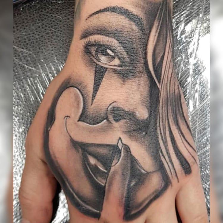 Chicano hand tattoo