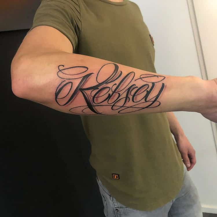 Freehand lettering tattoo Kelsey
