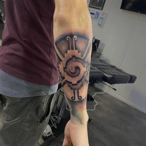 Hunab Ku teken Maya tattoo