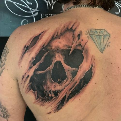 Ripped skin skull tattoo