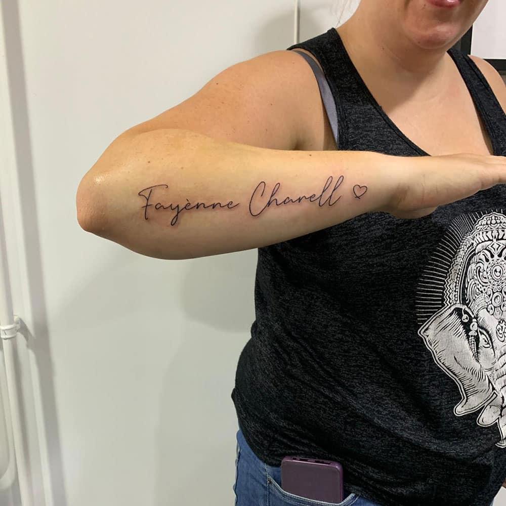 Fineline lettering tattoo