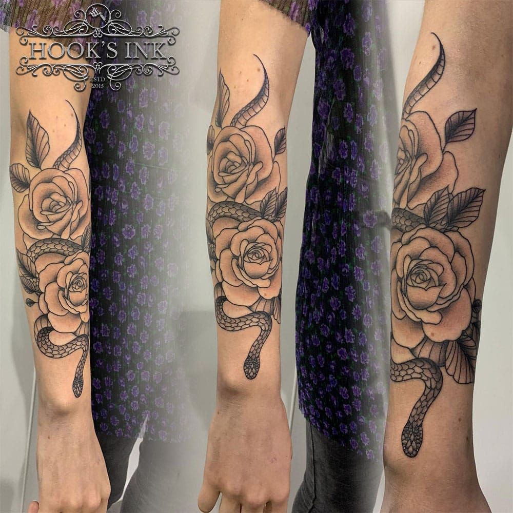 Old school tattoo slang met rozen
